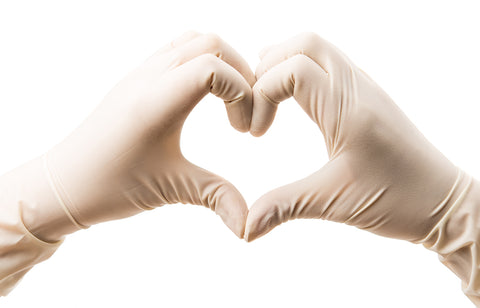 Two gloved hands forming a heart shape