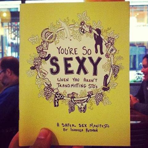 You're So Sexy When You Aren't Transmitting STIs (second edition) held by hand in cafe | Nikki Darling Australia