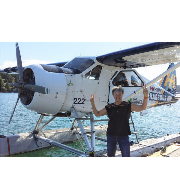 Cassandra in front of float plane