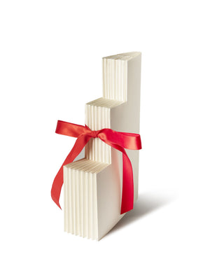 Folded Birthday Cake Invitation card tied with red ribbon