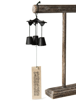 A hanging Japanese wind chime with hand-calligraphed wind catcher