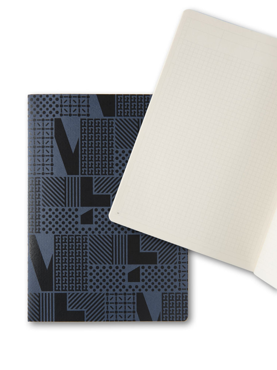 Opened notebook layying on blue cover notebook