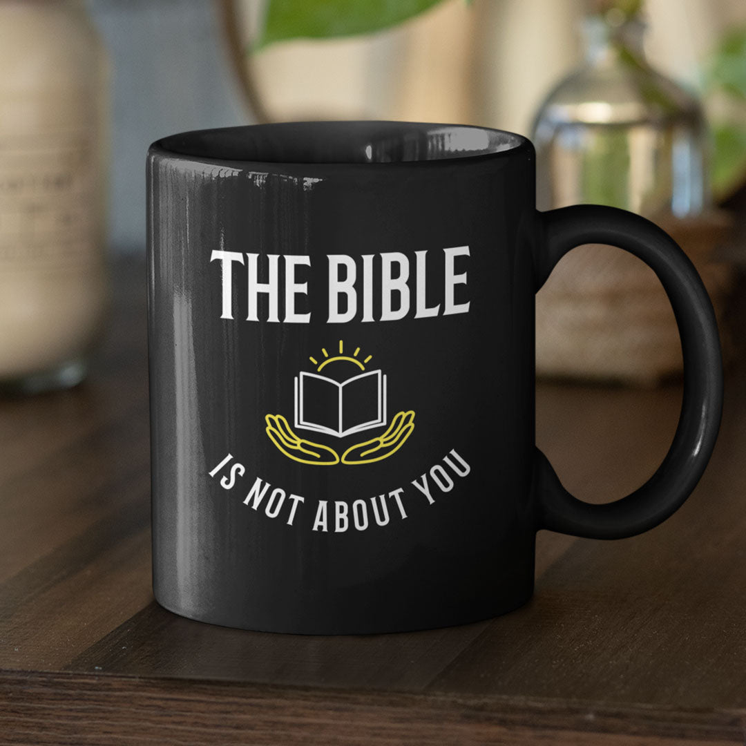 The Bible is Not About You! (11/15oz Black Mug)