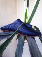 Ooze understated nautical chic in these slip-on navy blue bubble-leather tassel Moroccan babouches.