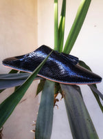 Elegant slip-on midnight black snakeskin leather tassel outdoor Moroccan babouches inspired by the legendary magic of La Mamounia in Marrakech.