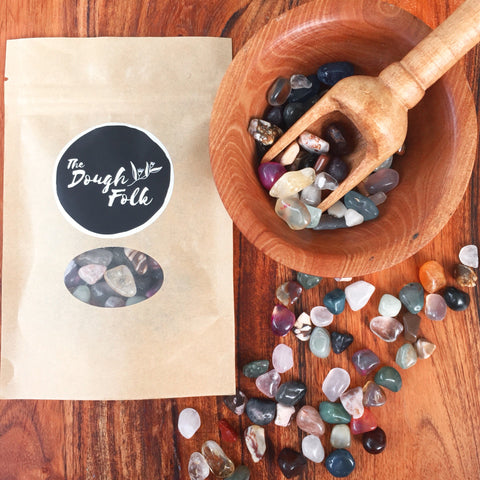 Small tumbled stones and crystal chips. Perfect addition to your NZ made play dough, sure to inspire a little sparkle in your child's sensory play. Part of our loose parts collection.