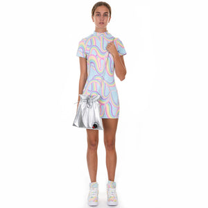 Model wears pastel printed dress while holding a  silver goon bag style handbag