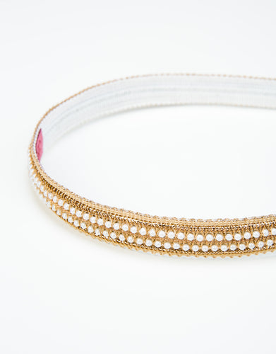 Close up of a pearl beaded, lace trimmed headband with a felt backing