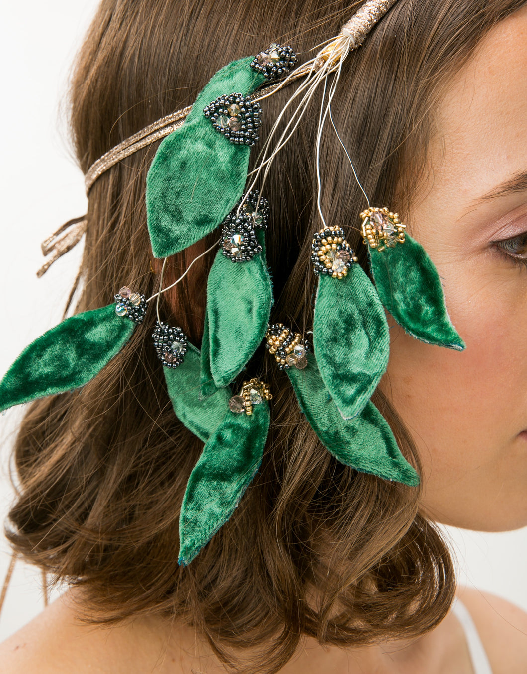 Close up of velvet leaves with bead details on headband