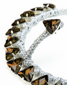 Close up of handmade silver headband with topaz triangle crystals and forehead crystal detail