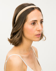Model wearing a pearl beaded, lace trimmed headband