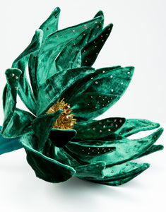 Close up of a velvet flower fascinator with Swarovski pearls, crystals and Japanese glass bead detailing