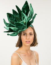 Load image into Gallery viewer, Women wearing an emerald green velvet flower fascinator with bead detailing on a green headband