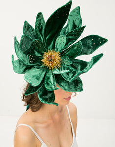 Woman with face obscured by velvet emerald flower fascinator with Swarovski pearls, crystals and Japanese glass beads