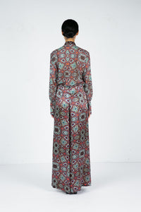 Back view of model wearing wide leg pant with moroccan tile print and matching blouse