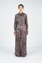 Load image into Gallery viewer, Front view of model wearing a wide leg pant with moroccan tile print and matching blouse
