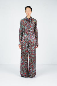 Front view of model wearing a wide leg pant with moroccan tile print and matching blouse