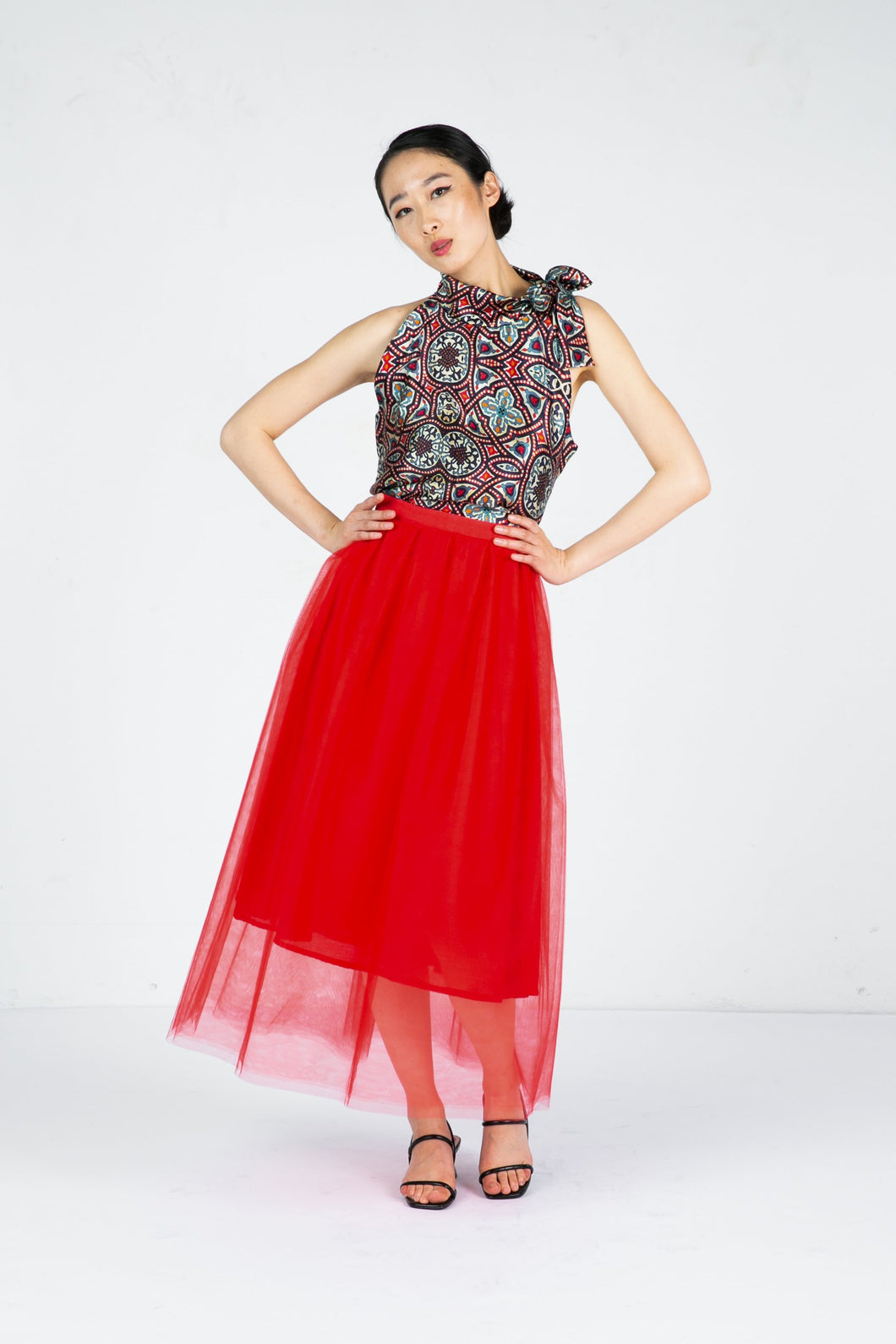 Model wears red tulle skirt with sleeveless printed top
