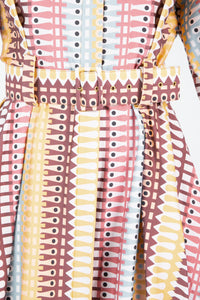 Close up of printed Avalon dress with matching printed belt