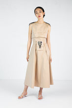 Load image into Gallery viewer, Model wears sleeveless tan dress with embroidered shoulder detail and embroidered belt