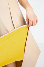 Load image into Gallery viewer, Close up of tan skirt with yellow lining
