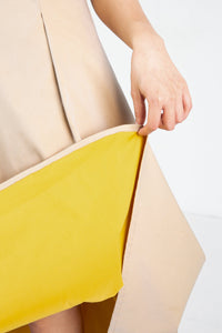 Close up of tan skirt with yellow lining