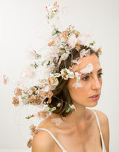 Load image into Gallery viewer, A woman wearing a fascinator with pastel silk petals hanging on silver wire to her shoulder