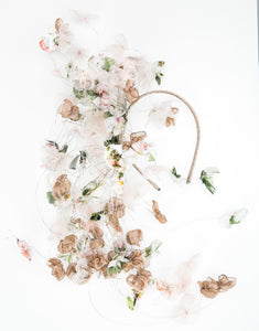 Fascinator with pastel silk petals on silver wire cascading off a metallic gold wire headband