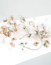 Load image into Gallery viewer, A fascinator with pastel silk petals hanging off a metallic gold headband