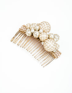 A gold metal hair comb with a cluster of hand wrapped pearls