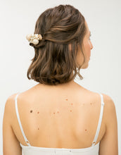 Load image into Gallery viewer, A hair comb with a cluster of hand wrapped pearls in a woman's hair