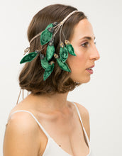 Load image into Gallery viewer, Side profile of model wearing beaded headband with velvet green leaves
