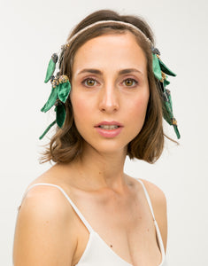 Front profile of model wearing beaded headband with green velvet leaf details