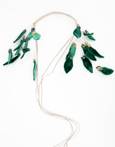 Flat lay of beaded headband with velvet leaf details and long tie
