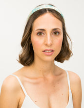 Load image into Gallery viewer, model wears a blue and gold floral brocade headband