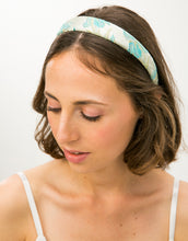 Load image into Gallery viewer, Top view of model wearing a blue and gold brocade headband