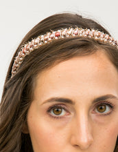Load image into Gallery viewer, Close up of a model wearing a gold headband with pink pearl embellishments