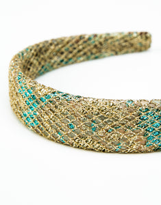 Close up of gold and blue brocade headband with gold netting overlay