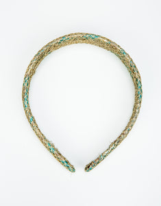 Flat lay of gold and blue brocade headband with gold netting overlay
