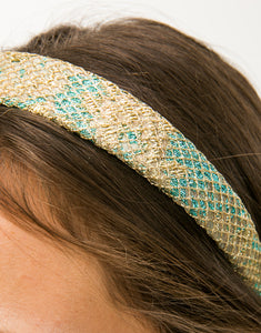 Close up of gold and blue brocade headband with gold netting overlay on model