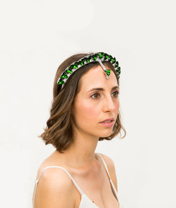Model wearing a silver headband embellished with green triangle crystals