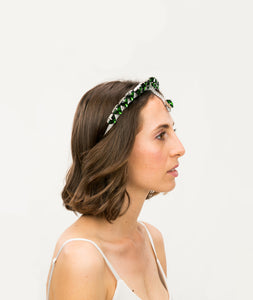 side profile of model wearing silver headband embellished with green triangle crystals