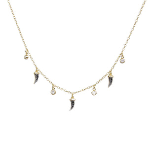 Gold choker with white sapphire and black spinel charms