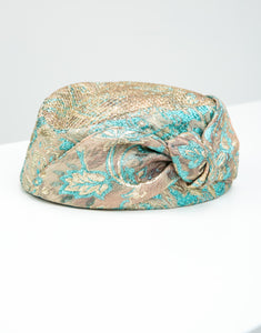 Blue and gold jacquard pillbox hat with knot detail