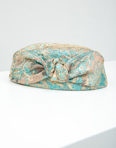 Front view of Jacquard pillbox hat with knot detail