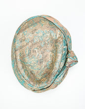 Load image into Gallery viewer, top view of jacquard pillbox hat with knot detail and gold netting