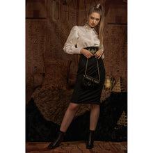 Load image into Gallery viewer, Model wears a white blouse with Eye of Ra embroidery on the collar with a black skirt