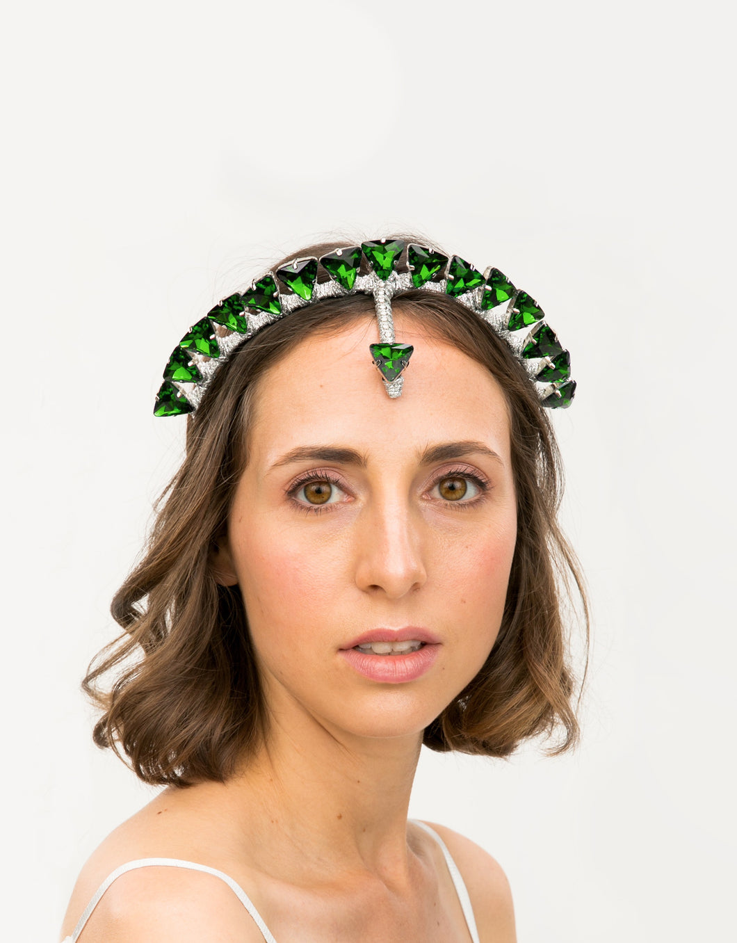 Model with headband embellished with green triangle crystals