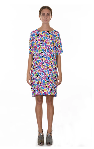 Standing model wearing multicoloured print knee length shirt dress