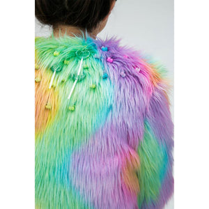 Close up of rainbow fur jacket with lollipop and gummy bear bead decorations